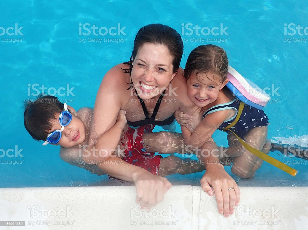 Mother and Children in a Pool stock photo