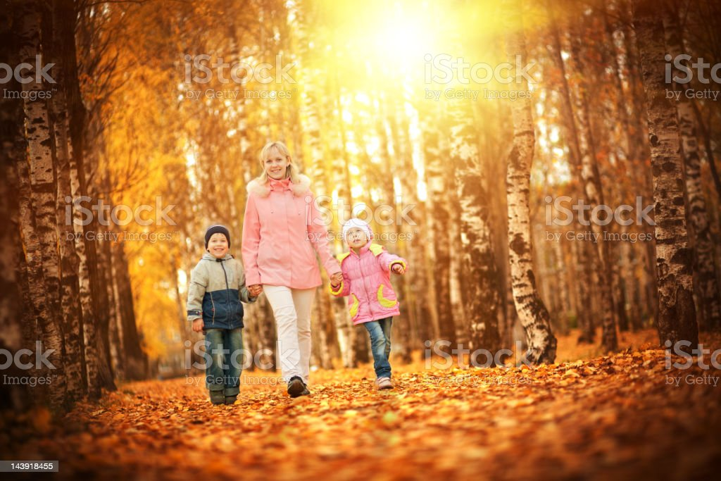 Mother and children in autumn park royalty-free stock photo