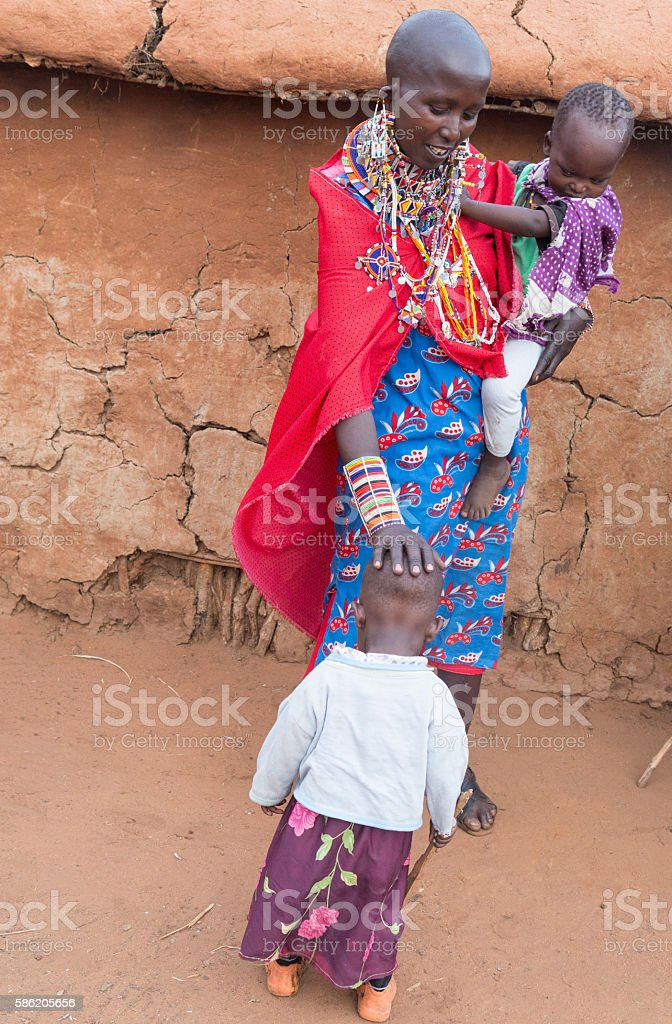 Mother and children in Maasai village, Kenya, East Africa. stock photo