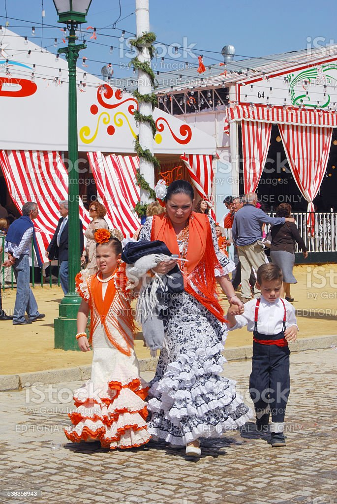 Mother and children in traditional dress, Seville. stock photo