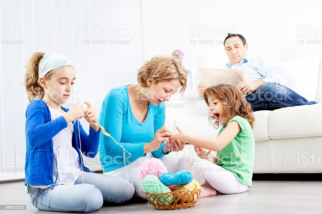 Mother and children knitting at home. royalty-free stock photo