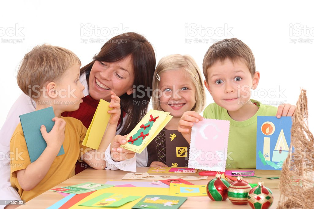 Mother and children making Christmas cards royalty-free stock photo