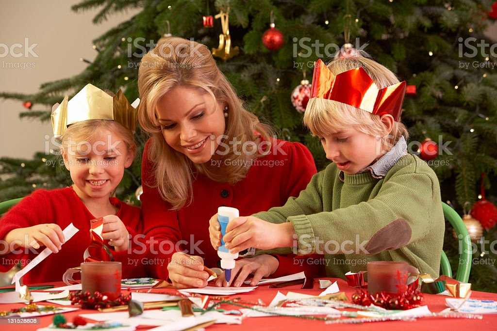 Mother And Children Making Christmas Cards Together royalty-free stock photo