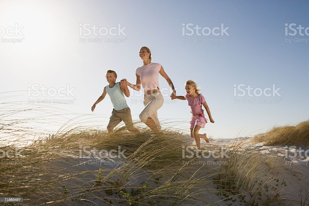 Mother and children on sand dunes royalty-free stock photo