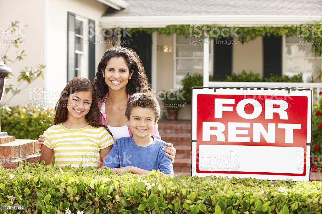 Mother and children outside home for rent stock photo