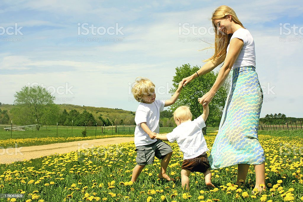 Mother and Children Playing Outside stock photo