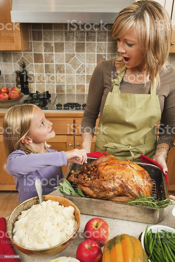 Mother and Children Preparing Thanksgiving Dinner in Home Kitchen Vt royalty-free stock photo