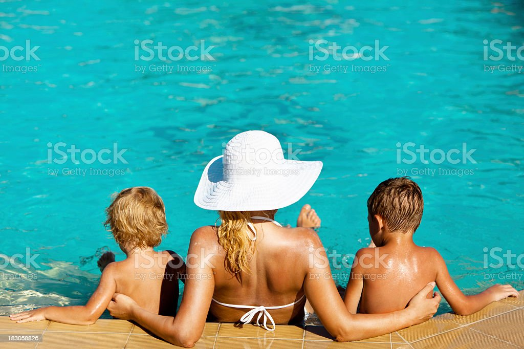 Mother and children sitting in the swimming pool royalty-free stock photo