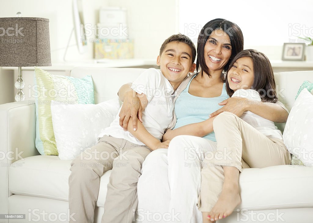 Mother and Children Sitting on a Sofa royalty-free stock photo