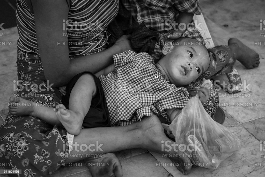 Mother and children with bare feet on the street stock photo