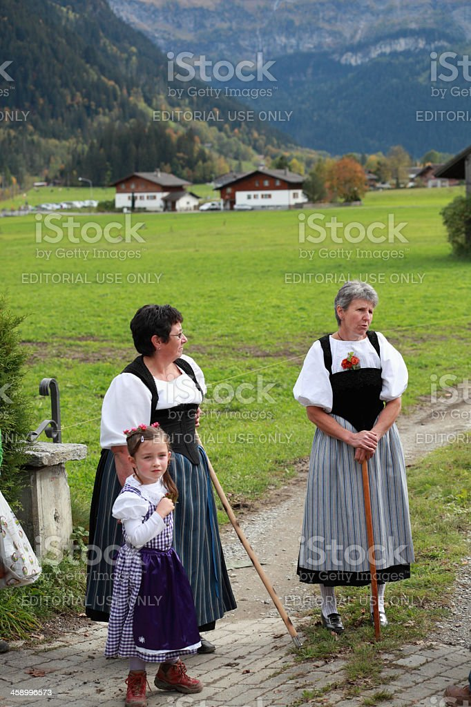 mother and cute daughter in traditional swiss costume stock photo