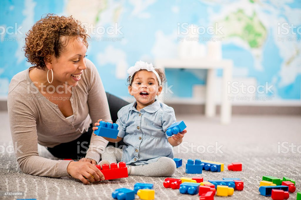 Mother and Daugher Playing at Daycare stock photo