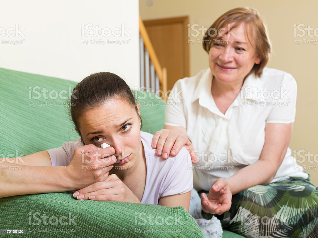mother and daughter  after quarrel stock photo