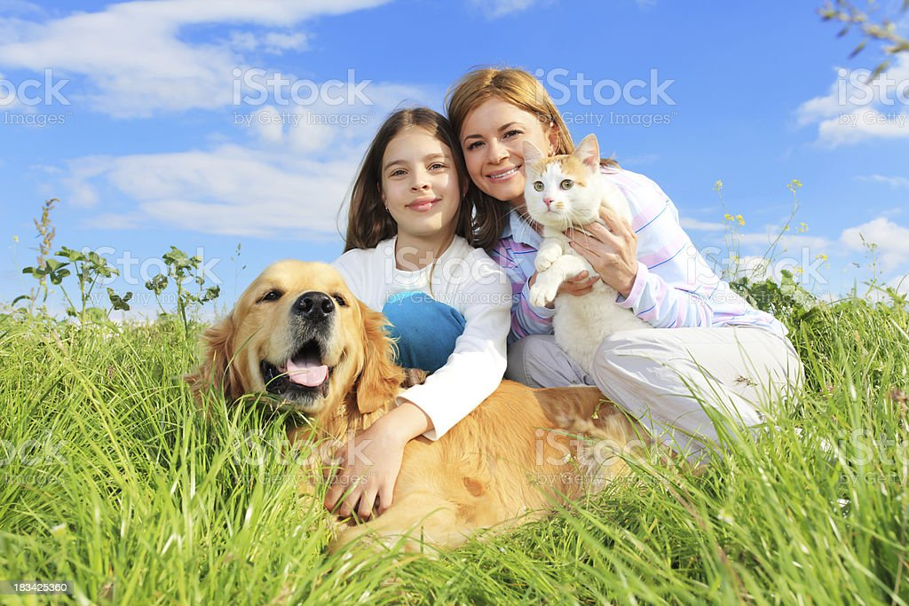 Mother and daughter are enjoying outdoor with pets royalty-free stock photo