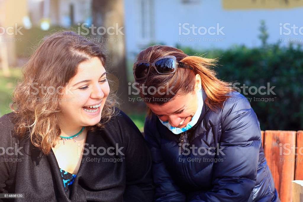 Mother and daughter are having fun chatting stock photo