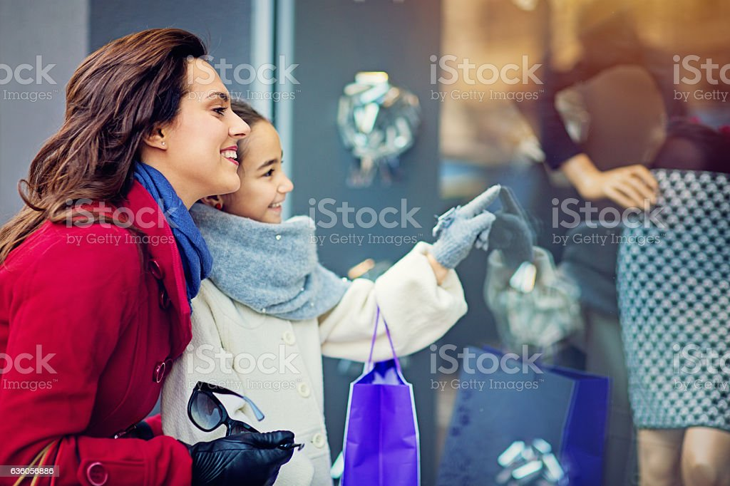 Mother and daughter are walking on the street stock photo