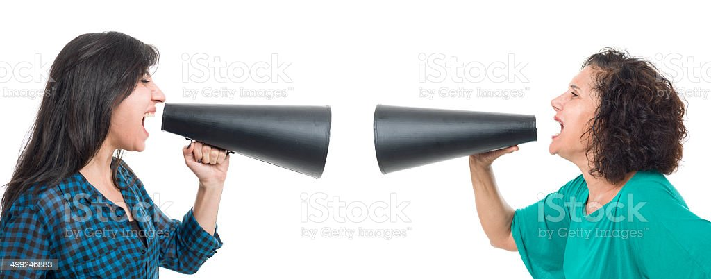 Mother and daughter arguing via megaphone royalty-free stock photo