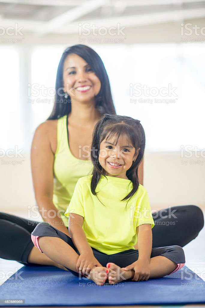 Mother and Daughter at Fitness Class stock photo