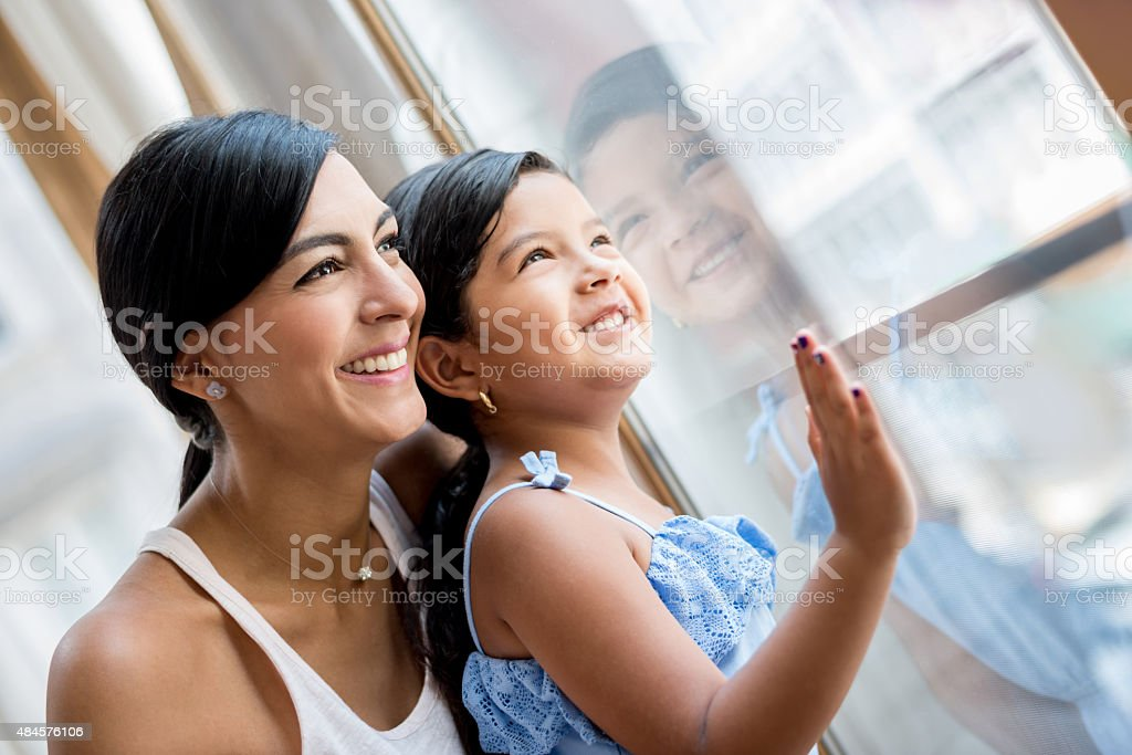 Mother and daughter at home stock photo