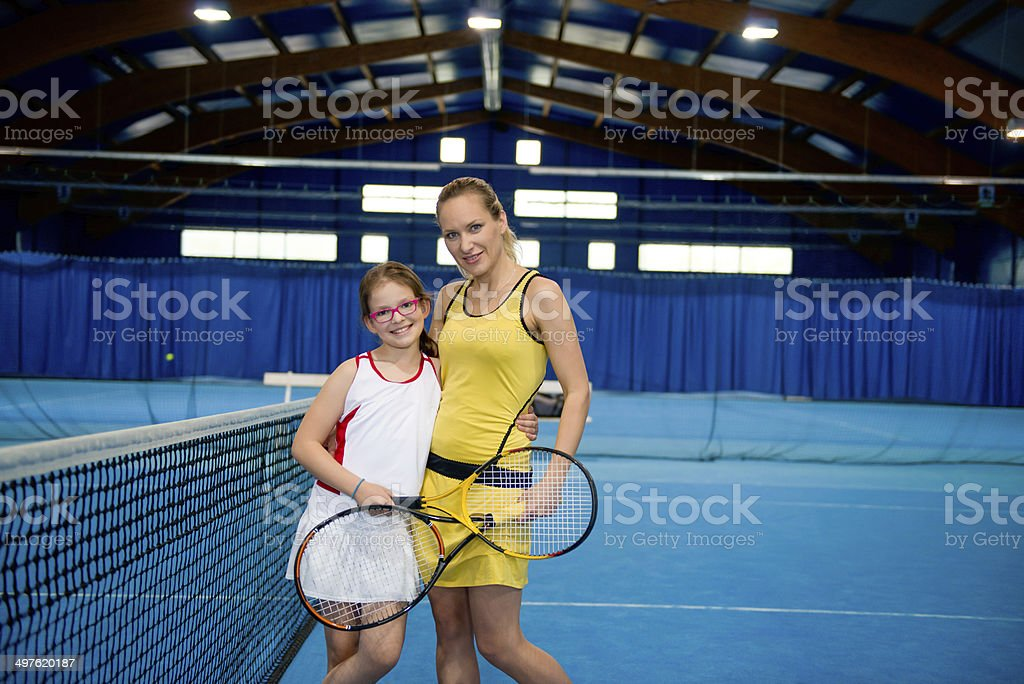 Mother and Daughter at Indoor Tennis Net royalty-free stock photo