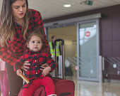 mother and daughter at the airport door