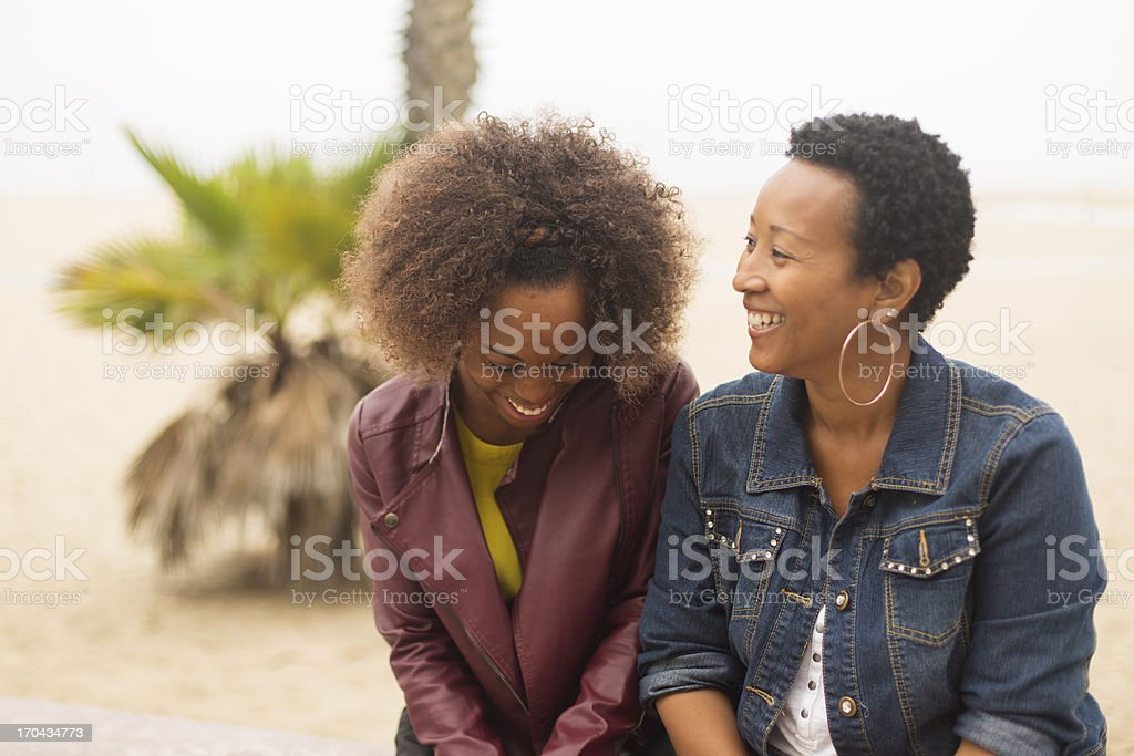 Mother and Daughter at the Beach stock photo