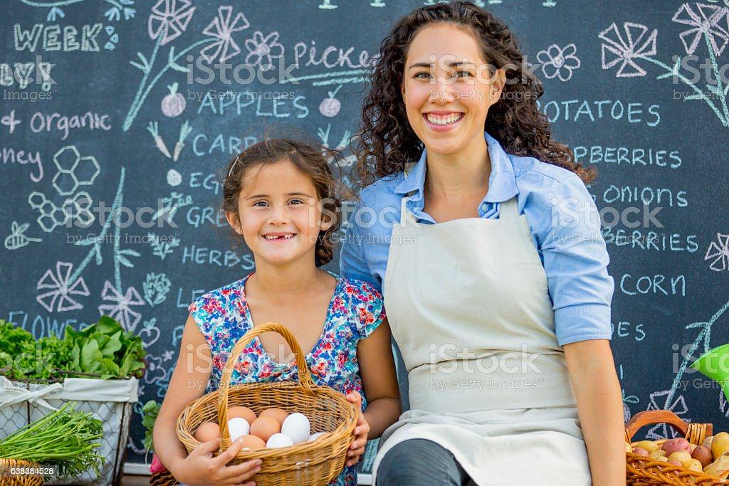 Mother and Daughter at Their Farm Stand stock photo