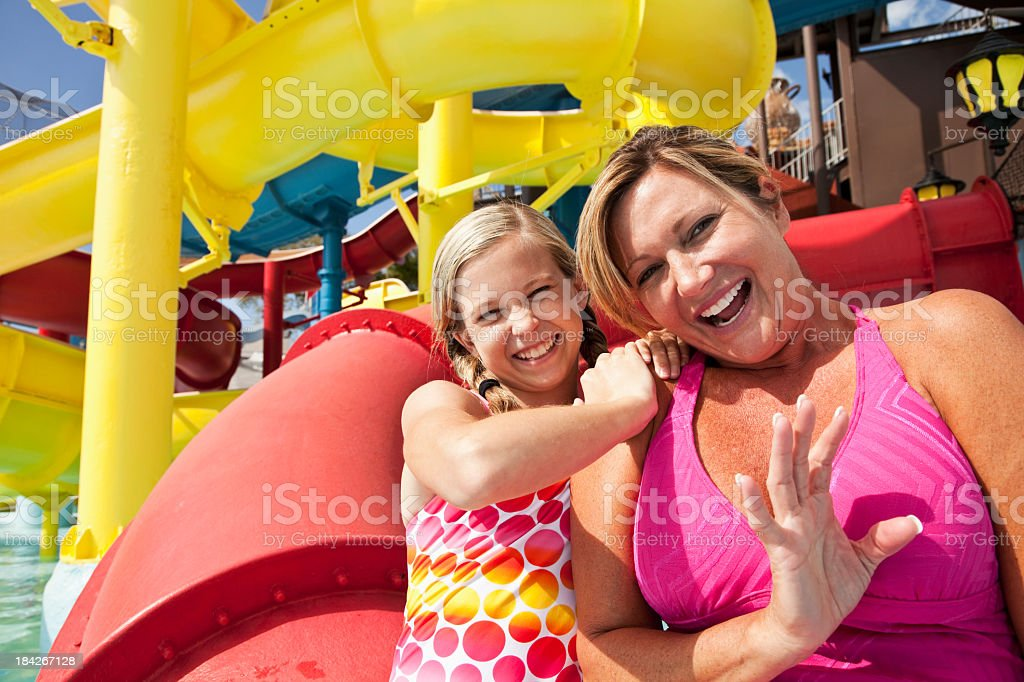 Mother and daughter at water park royalty-free stock photo