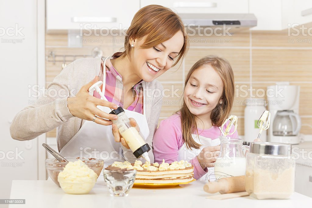 Mother and daughter baking cake royalty-free stock photo