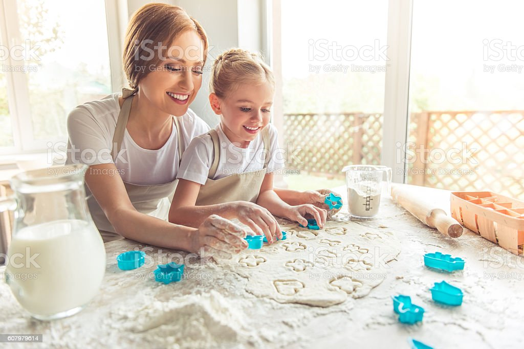 Mother and daughter baking stock photo