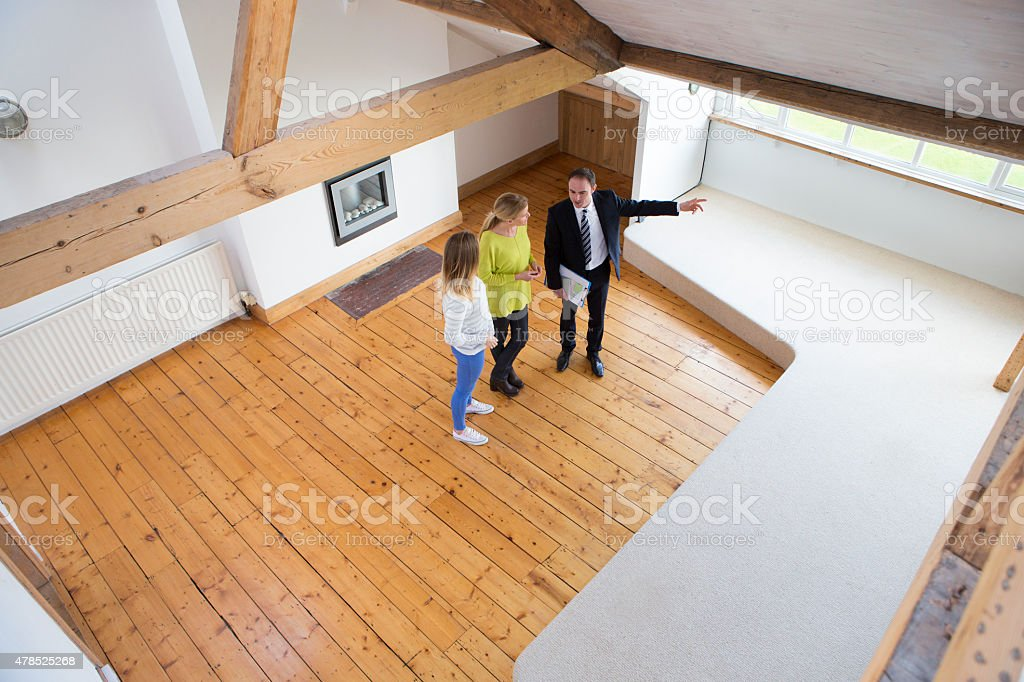 Mother and Daughter Being Shown a New Home stock photo