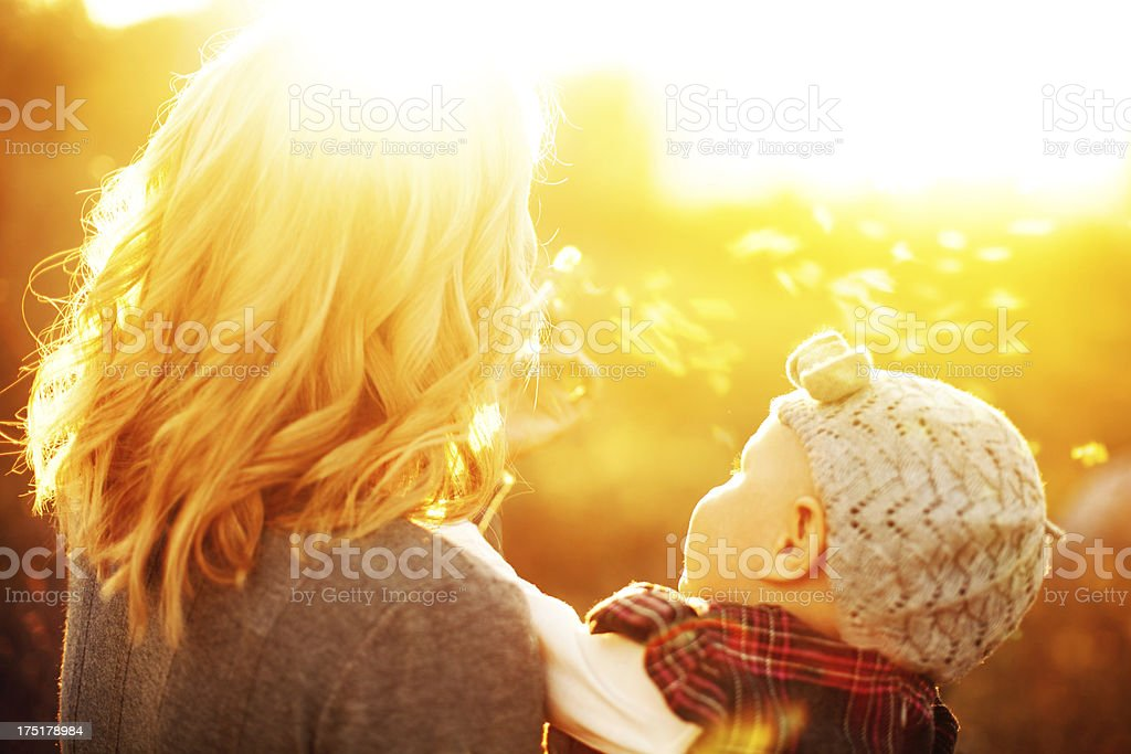 Mother and daughter blowing a dandelion royalty-free stock photo