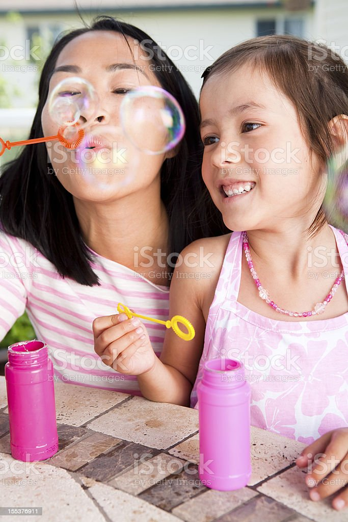 Mother and Daughter blowing bubble royalty-free stock photo