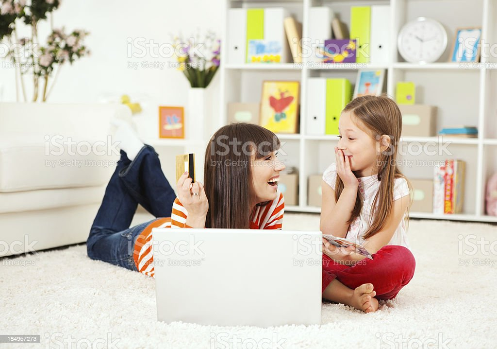 Mother and daughter buying on internet. royalty-free stock photo