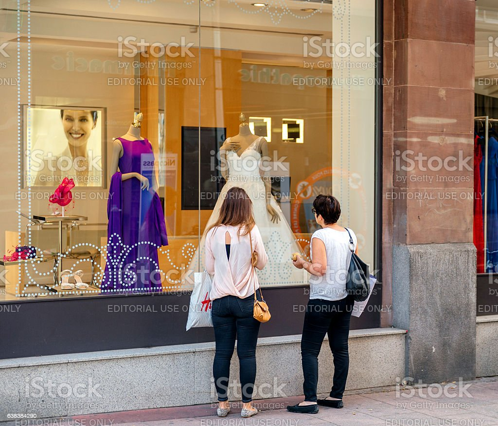 Mother and daughter buying wedding dress at fashion store boutiq stock photo