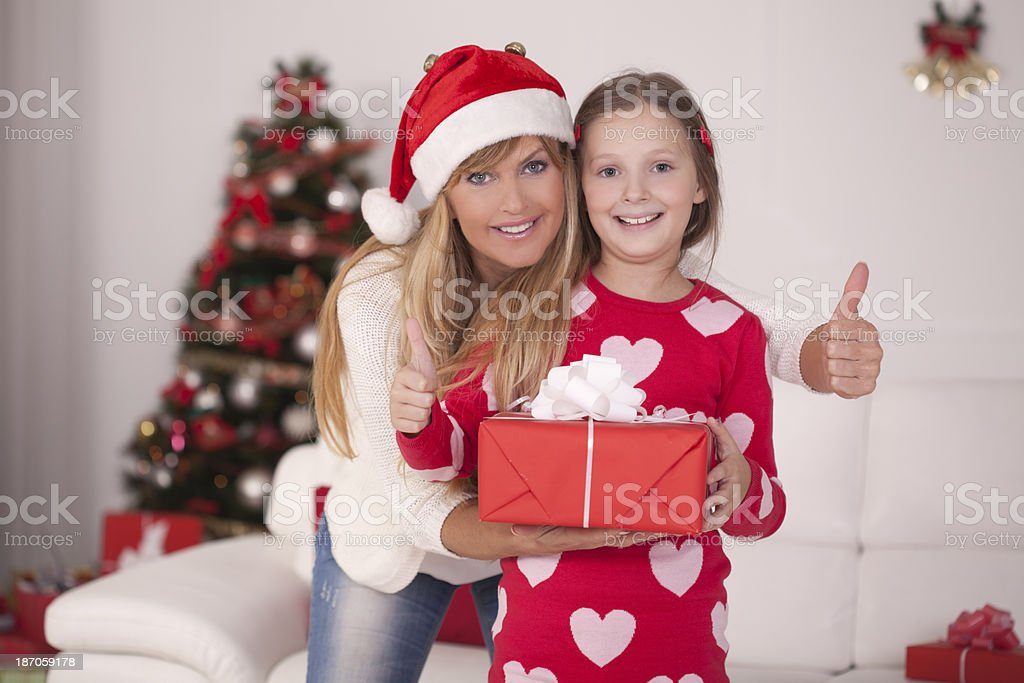 Mother and daughter by christmas tree. royalty-free stock photo