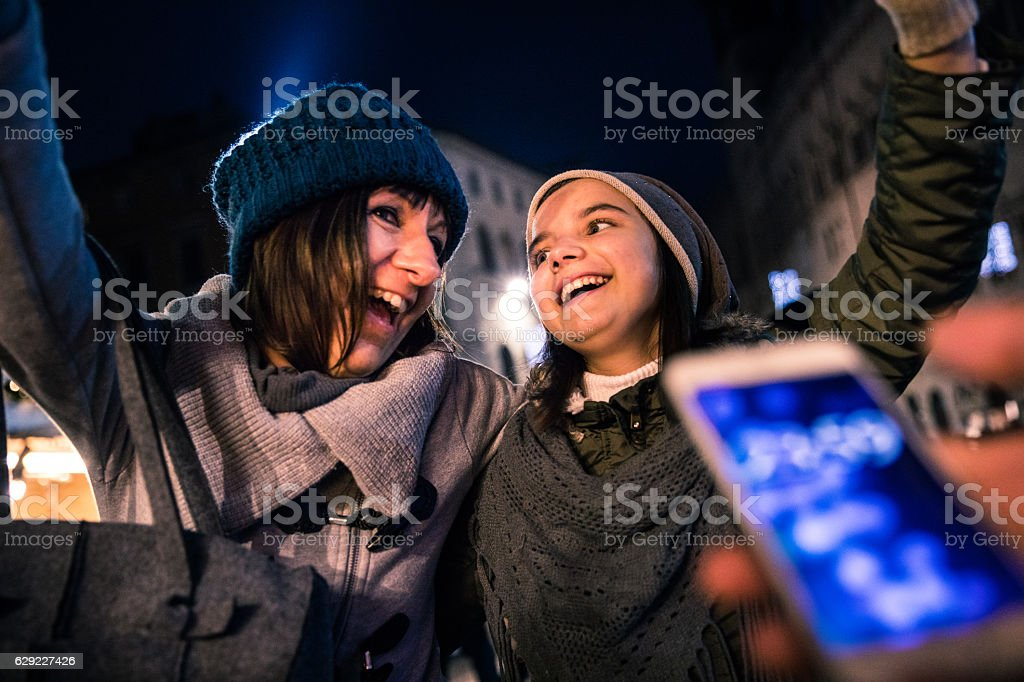 Mother and daughter celebrate New Year's Eve together stock photo
