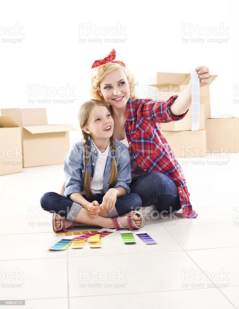 Mother and daughter choosing colors royalty-free stock photo