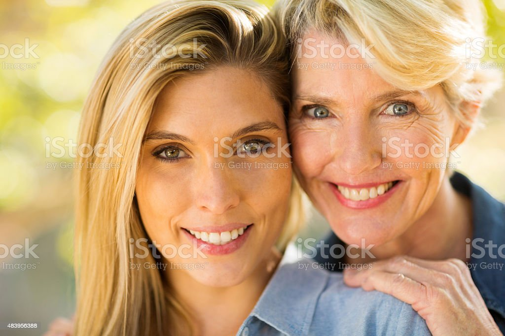 mother and daughter close up stock photo