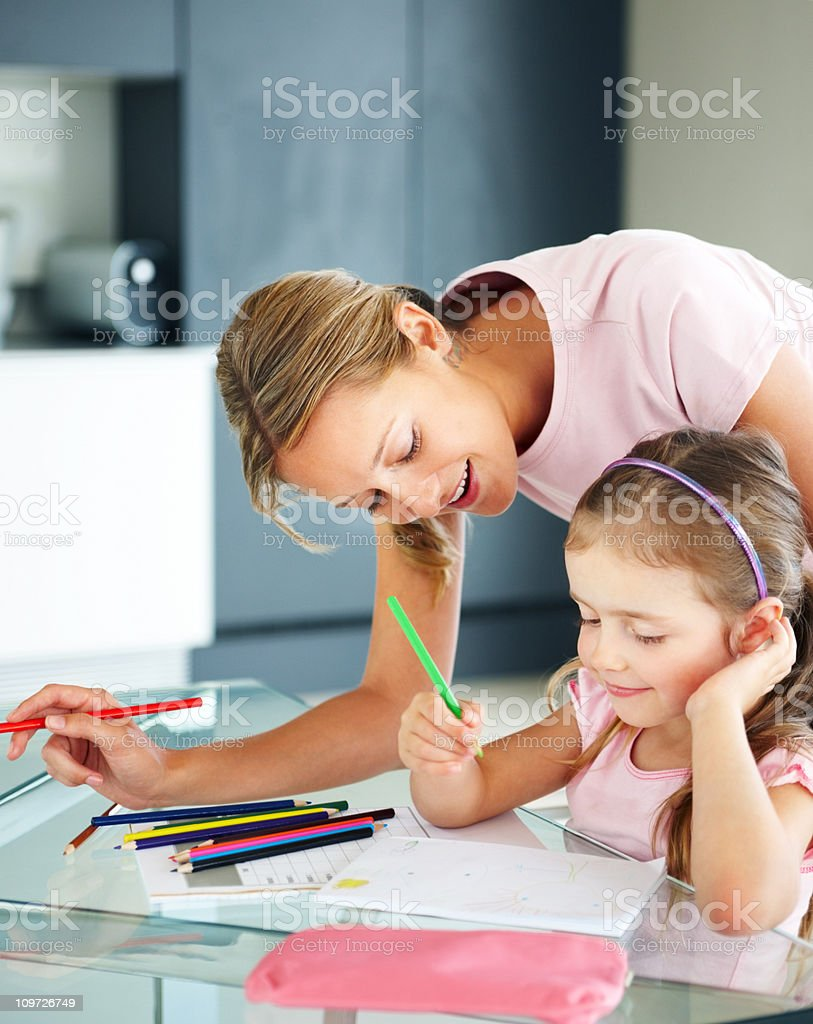Mother and Daughter Colouring at Table royalty-free stock photo