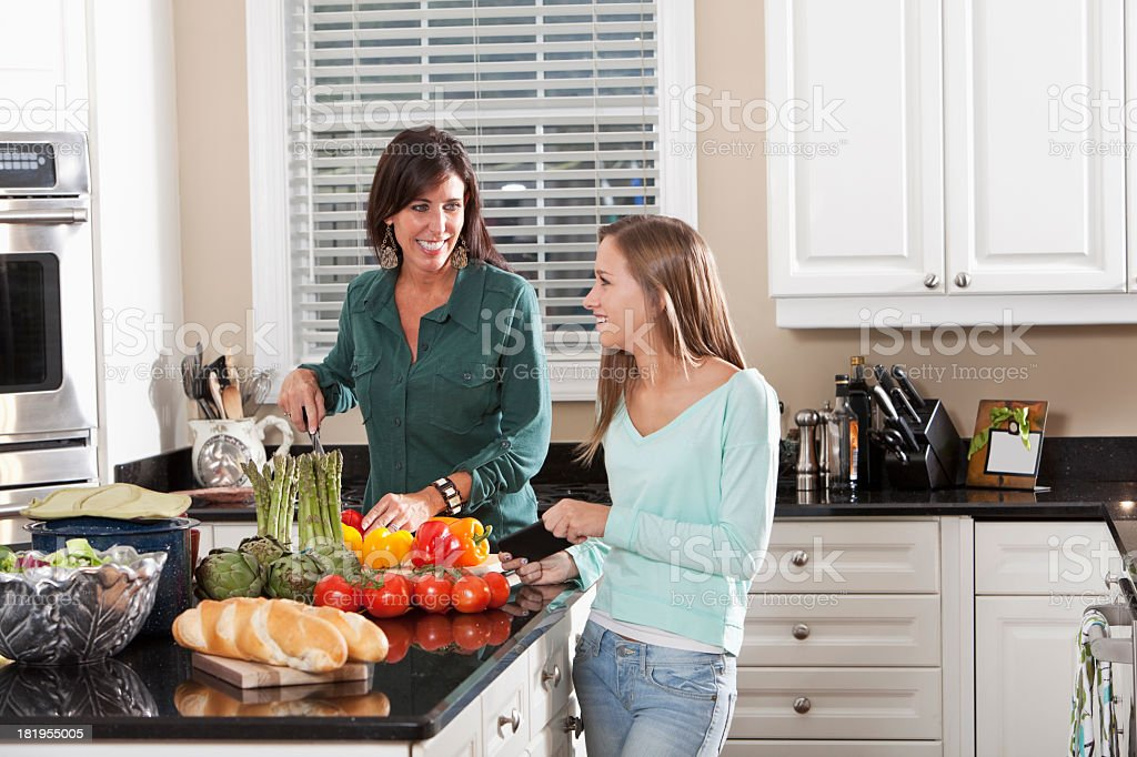 Mother and daughter cooking, talking royalty-free stock photo