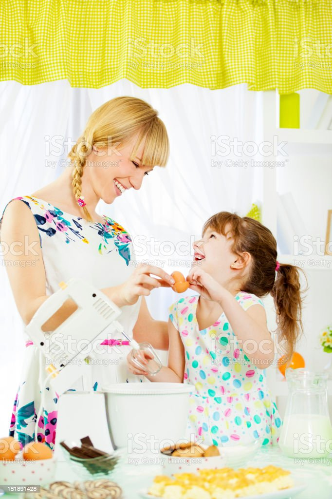 Mother and daughter Cooking Together. royalty-free stock photo