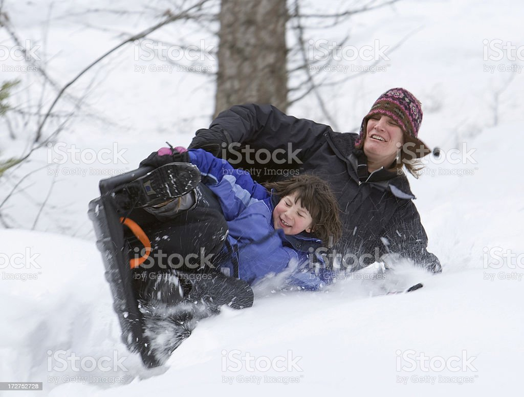Mother and Daughter crash while sledding royalty-free stock photo