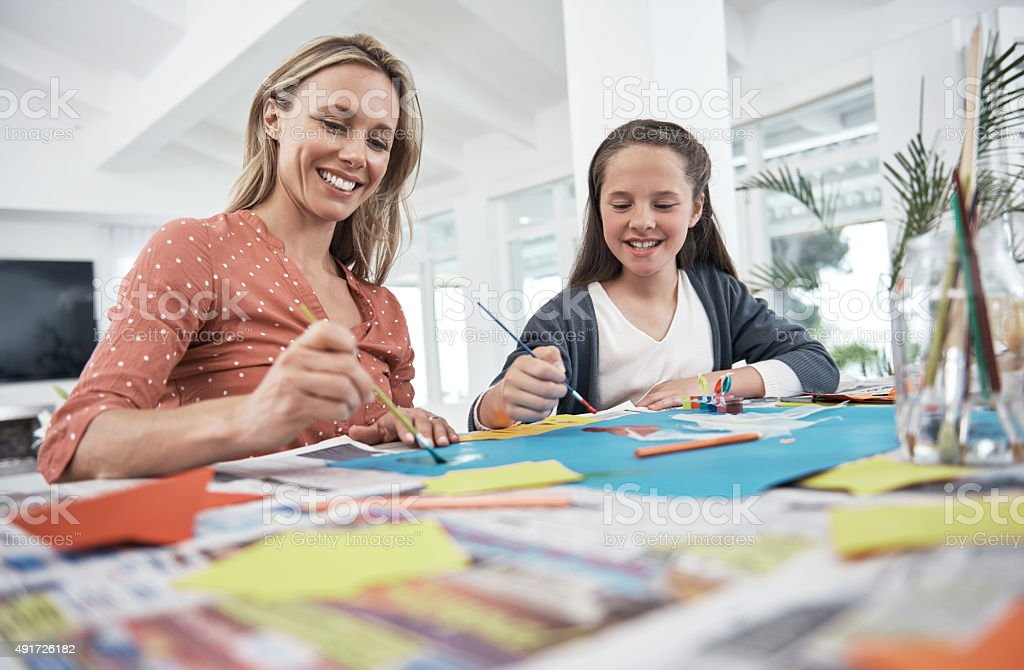 Mother and daughter creativity stock photo