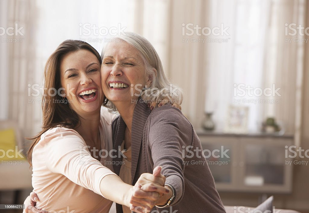 Mother and daughter dancing stock photo