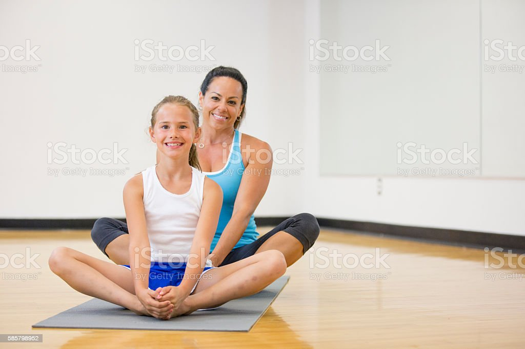 Mother and Daughter Doing a Yoga Class stock photo
