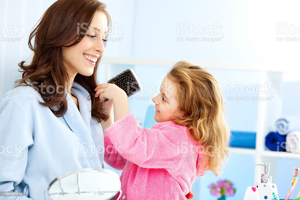 Mother and Daughter Doing Hairbrush royalty-free stock photo