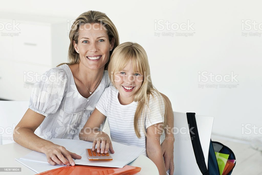 Mother and Daughter Doing Homework Together royalty-free stock photo