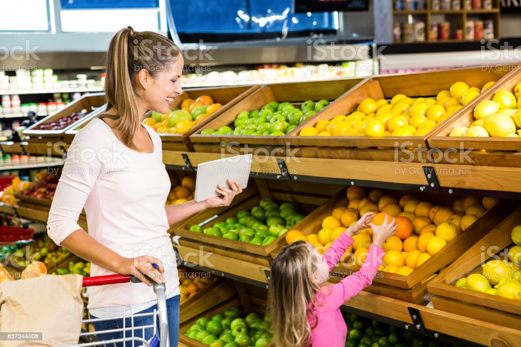 Mother and daughter doing shopping stock photo