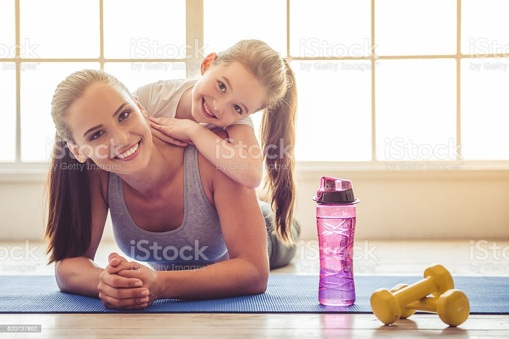 Mother and daughter doing sport stock photo